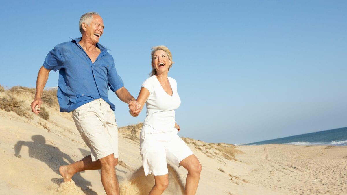 restorative dental patients running on beach
