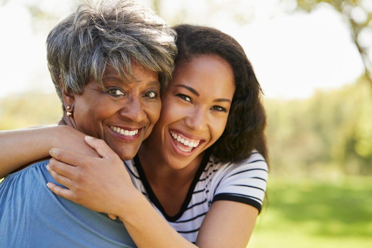 elderly denture patient with her daughter