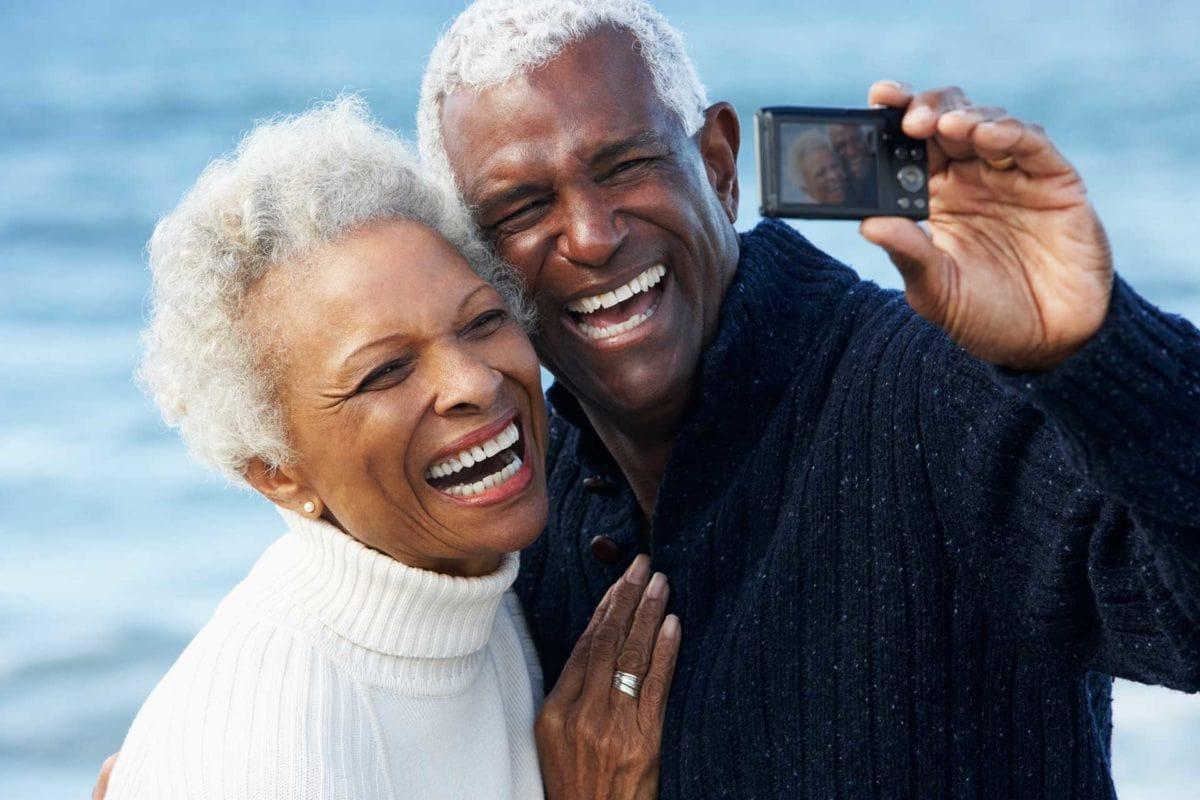 veneer patients taking selfie while showing off new veneers